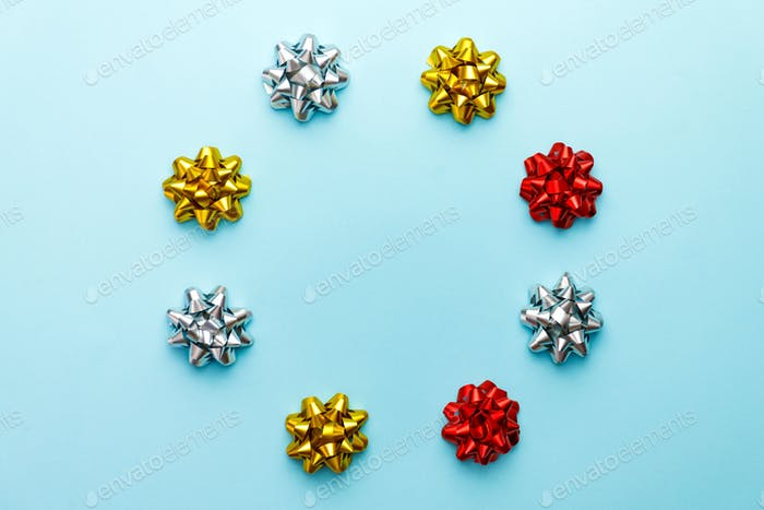 Christmas bows on blue. Decorations for holidays or party.
