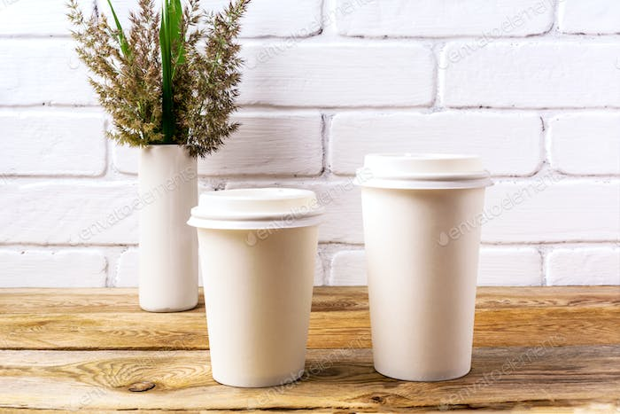 Paper coffee cups mockup with cord wild grass