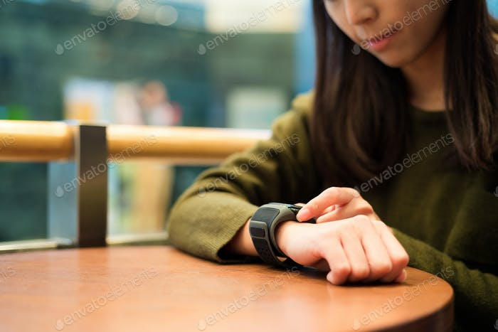 Woman use of touch on the smart watch