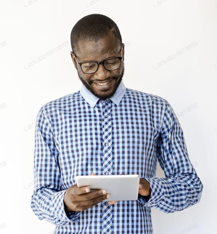 Adult Man Smile Use Tablet Studio Portrait
