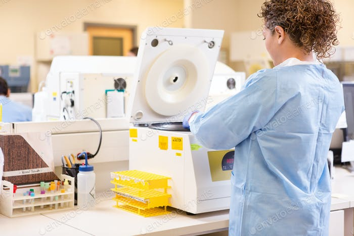 Scientist Using PCR Machine In Laboratory