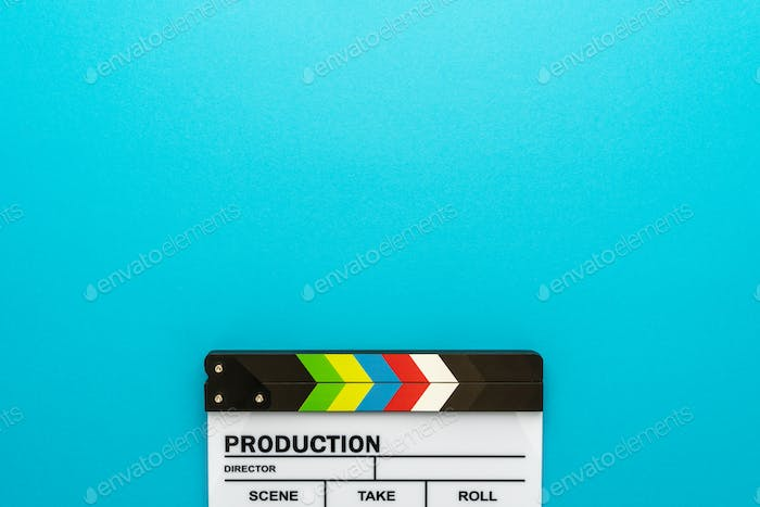 Top View Of Clapperboard At Bottom Of Turquoise Blue Background With Copy Space