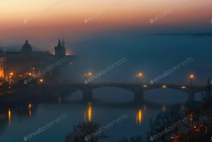 Charles bridge during foggy morning at Prague