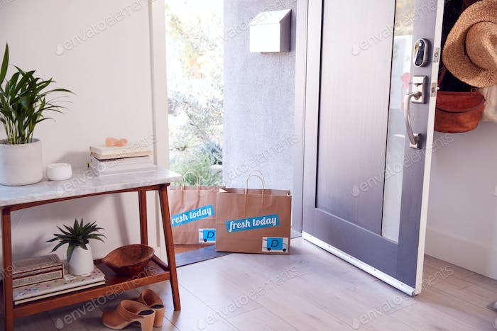 Open Front Door Of House With Home Delivery Food Bags