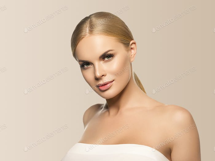 Beauty woman healthy skin natural makeup close up face. Beige background.