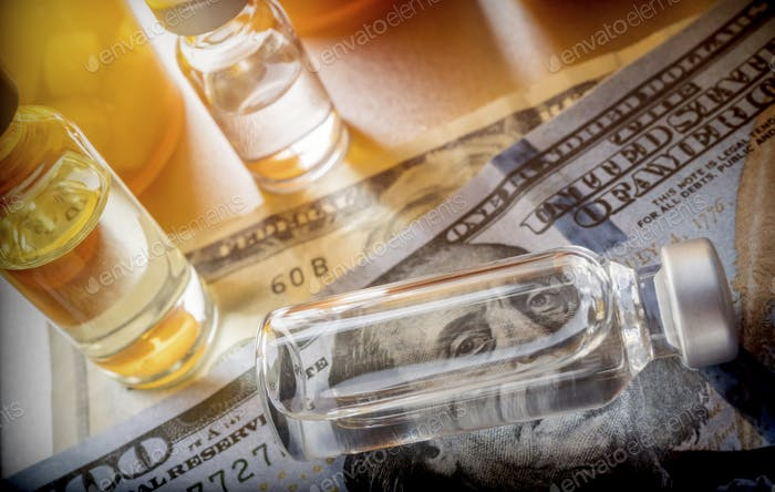 vials with different substances over dollar, concept of copayment
