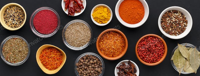 Spice background. Colourful seasonings in bowls, top view