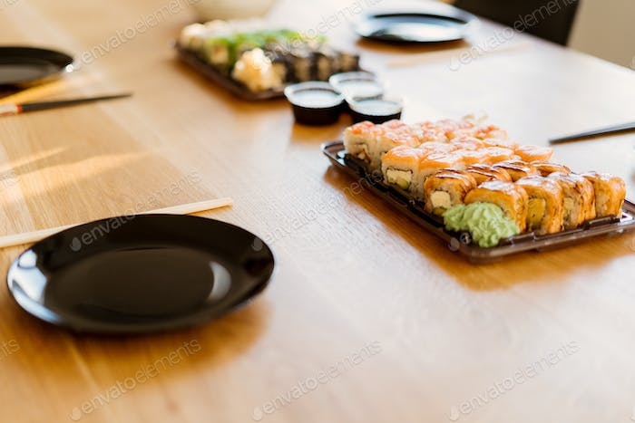 Waiting for friends with sushi rolls