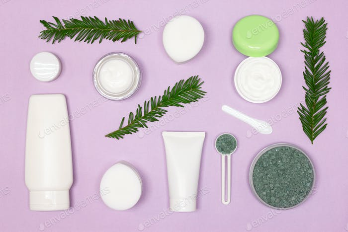 Beauty cosmetic products with green leaves layout