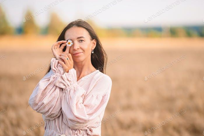Beautiful woman in dress in wheat field