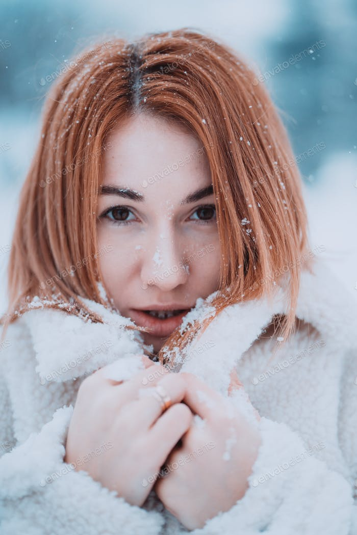 Portrait female model outside in first snow