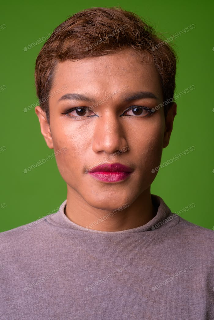 Androgynous young Asian man wearing makeup