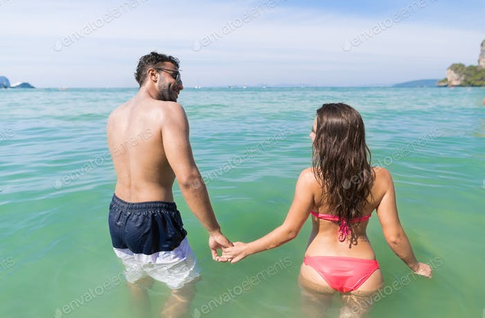 Couple On Beach Summer Vacation, Young People In Water , Man Woman Holding Hands Sea Ocean