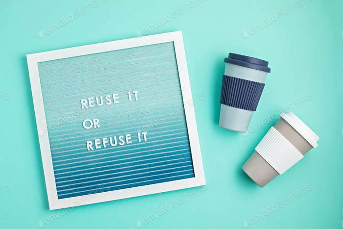 Reusable coffee cup and letterboard with text reuse it or refuse it. Zero waste sustainable