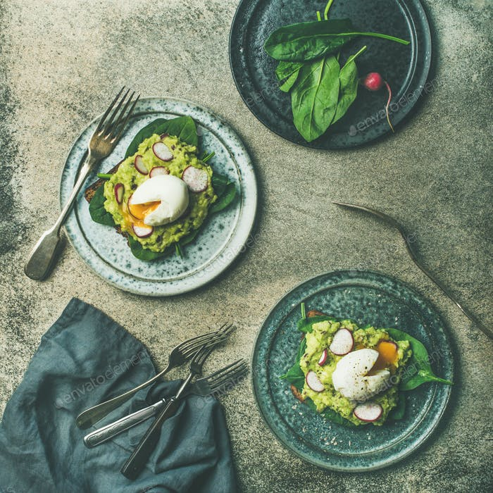 Healthy vegetarian wholegrain avocado toasts with poached egg, square crop