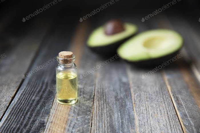 Avocado Oil on Wooden Table