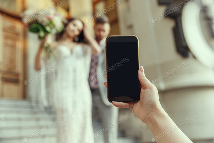 Caucasian romantic young bride celebrating his marriage in city