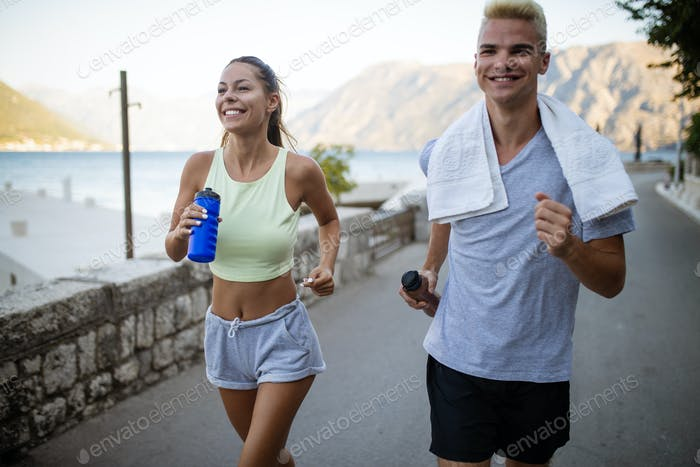 Healthy sporty lifestyle. Happy fit people friends exercising and running outdoor