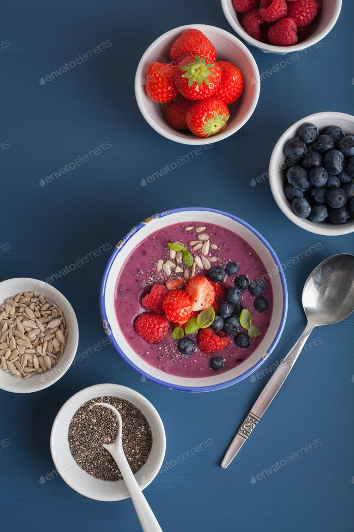 healthy berry smoothie bowl with strawberry blueberry raspberry