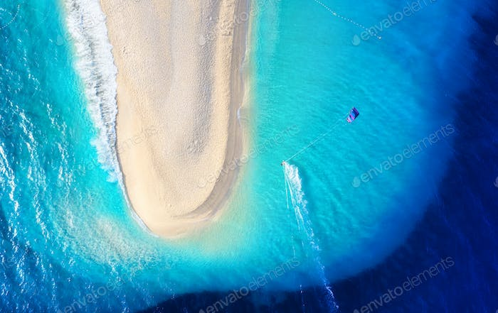 Aerial view on the beach and windsurfer. Beach and sea from air. Famous place in Croatia.