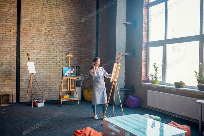 Beautiful talented woman working in the studio