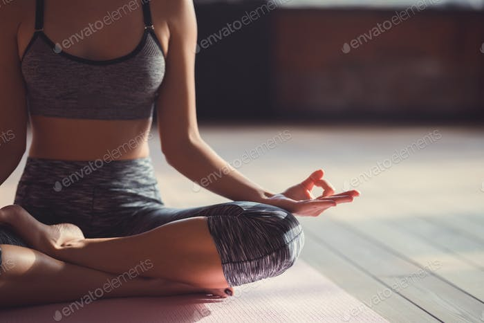 Young girl in a lotus pose