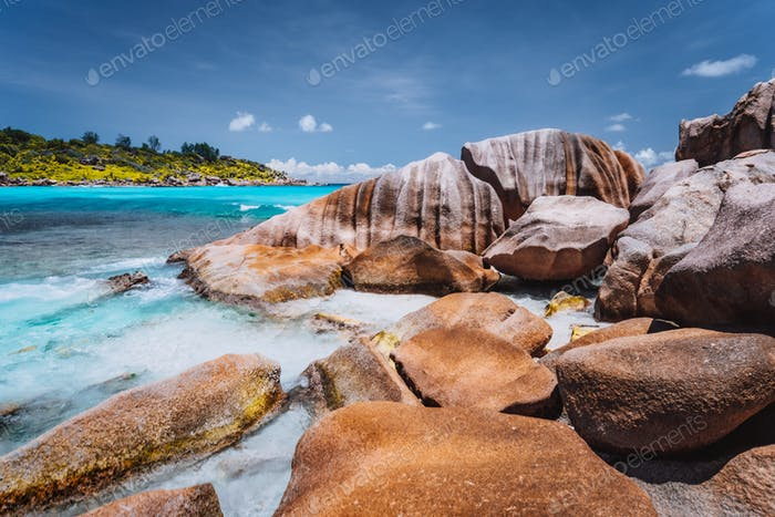 Tropical beach at Seychelles. Rocks on shore of La Digue Island