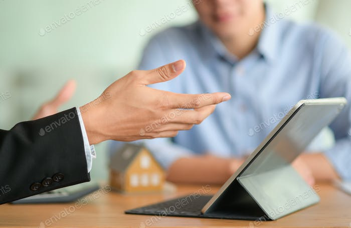 Close-up shot of Insurance broker is introducing a health insurance program with his tablet.