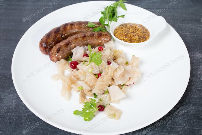 Grilled sausages with sauerkraut.