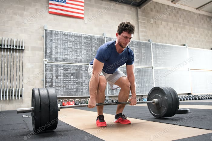 Athlete starting a deadlift in a crossfit gym