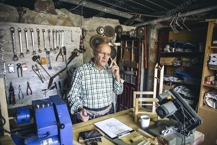 Carpenter in his workshop
