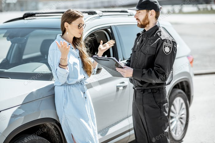 Policeman with female driver on the roadside