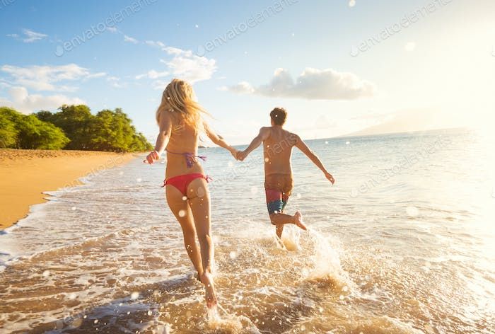 Happy Couple on Tropical Beach at Sunset