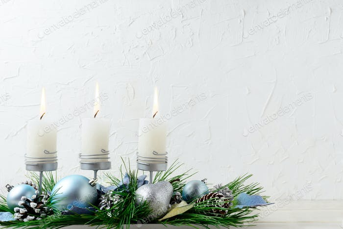 Christmas background with blue ornaments and burning candles