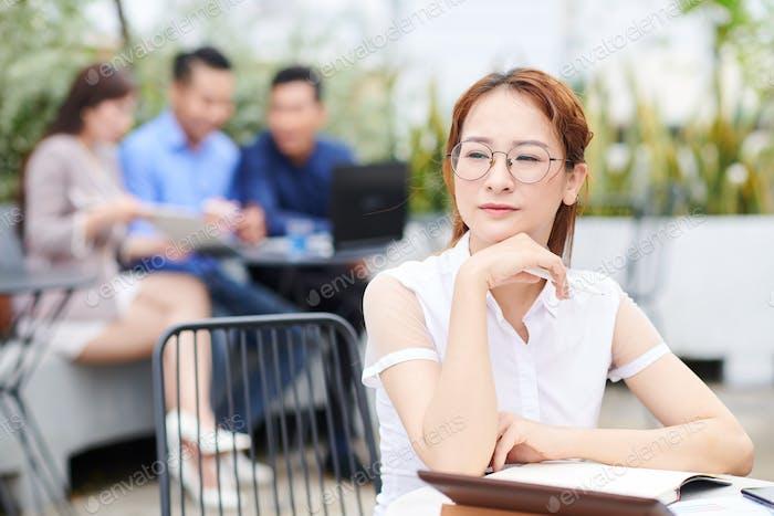 Pensive Vietnamese businesswoman