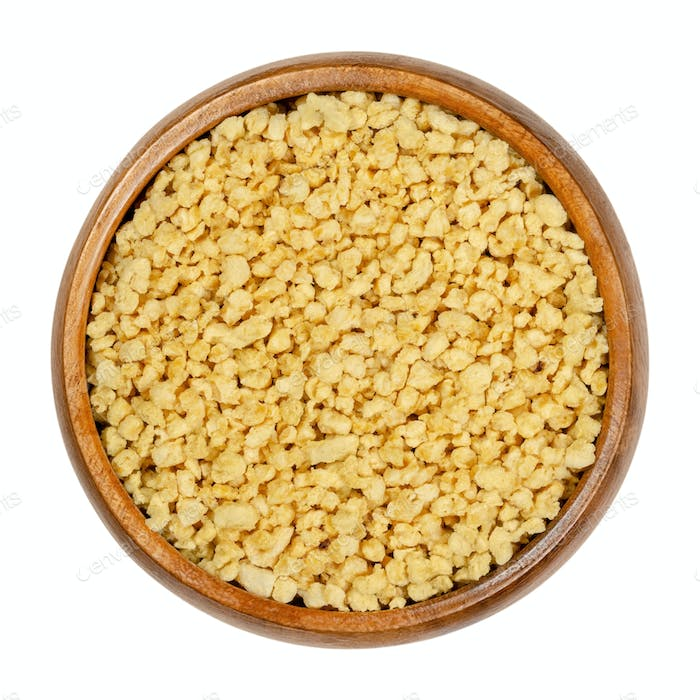 Soya granules, textured soy protein, soy meat in wooden bowl
