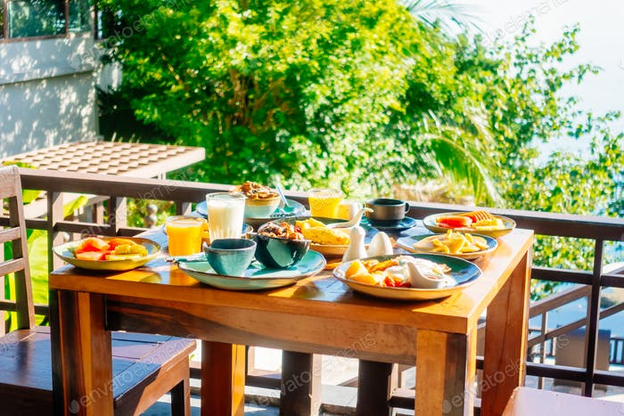 Healthy breakfast set with egg bacon pancakes orange juice milk