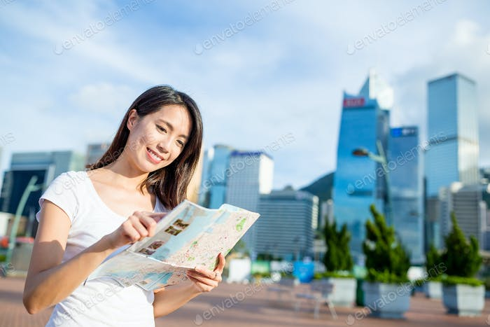 Woman searching the location on city map