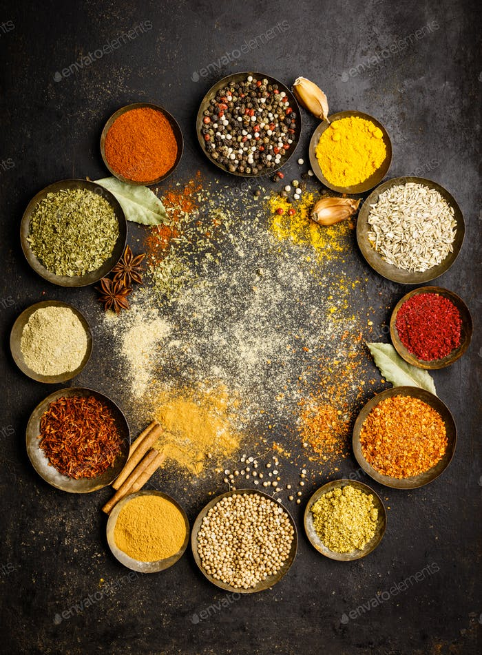 Thumbnail for Various bowls of spices over dark background
