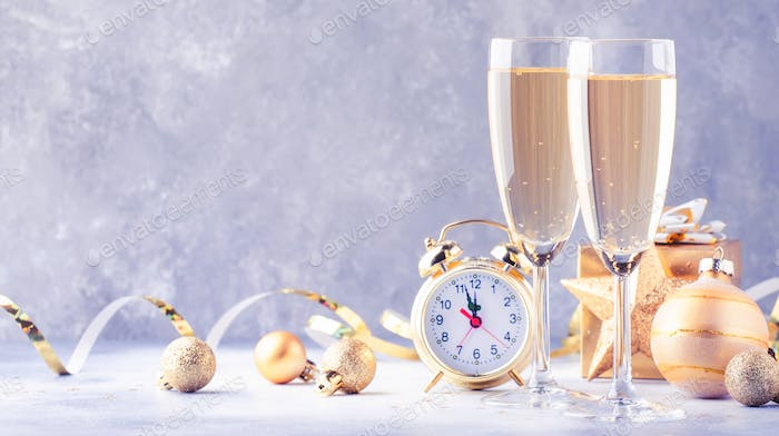 Two champagne glasses and christmas decoration