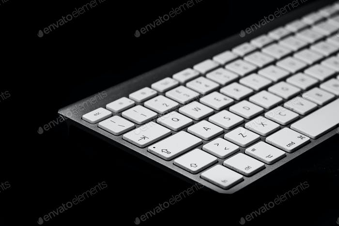Personal computer keyboard on black background