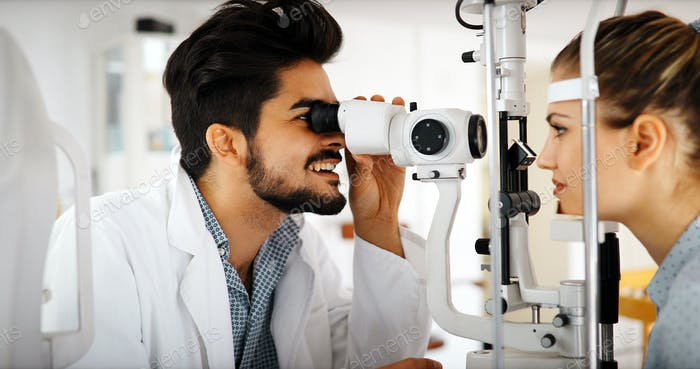 optometrist checking patient eyesight and vision correction
