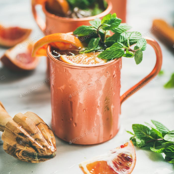 Blood orange Moscow mule alcohol cocktails, square crop