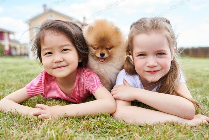 Little Girl Posing with Puppy