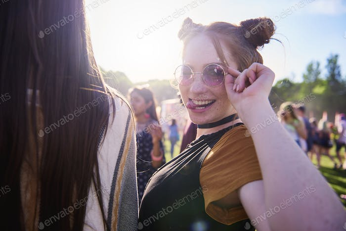 Portrait of young hippy woman in sunglasses at festival