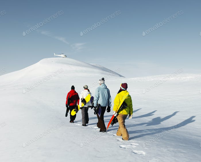 Group of snowboarders enjoying a beautiful Winter morning Concep