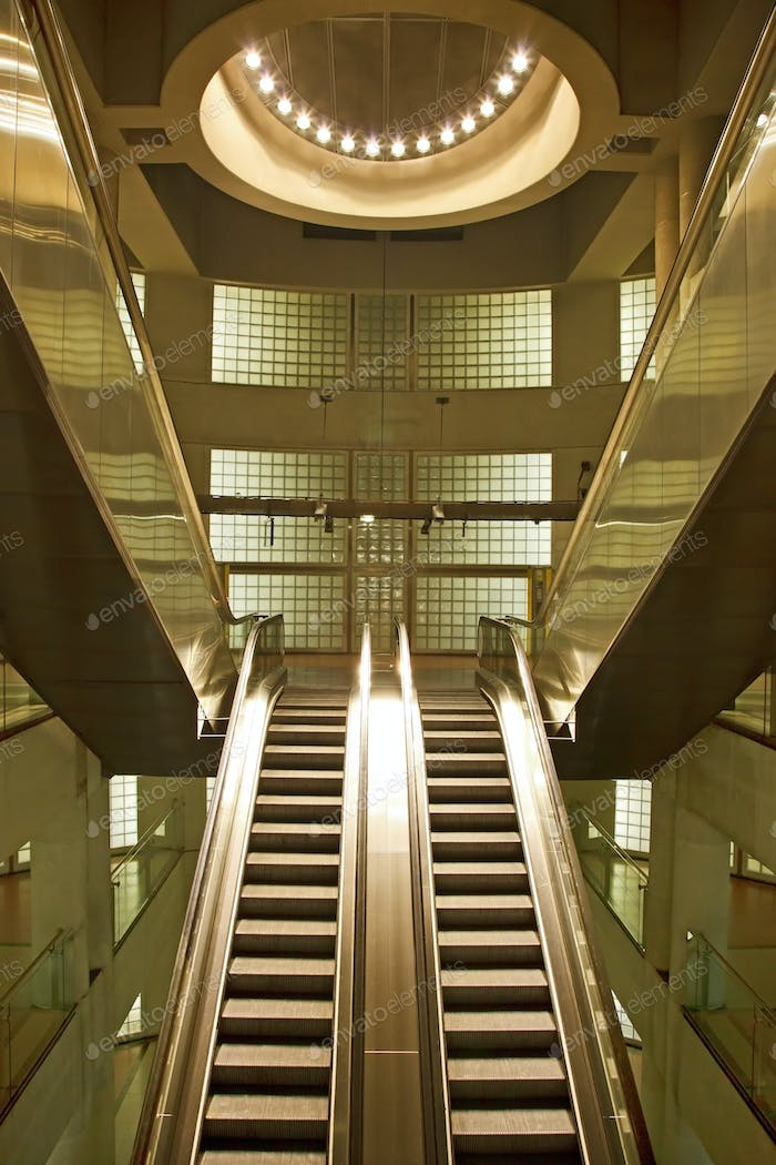 Golden interior escalator in business architecture