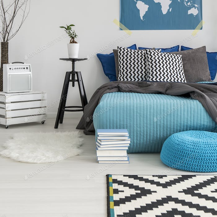 Modern bedroom with world map poster