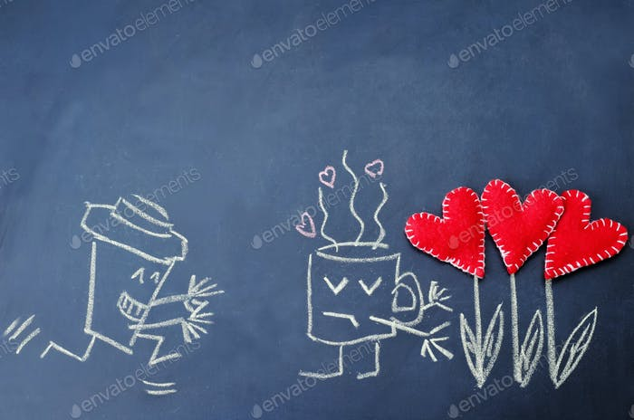 cups of coffee with toy hearts drawn on the chalkboard