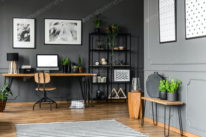 Black rack with decorations standing next to a wooden chair and